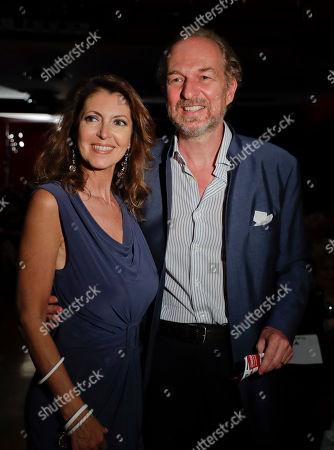 Italian entrepeneur Arturo Artom is flanked by his wife Alessandra Repini as they attend 'La Milanesiana' cultural event, at the Piccolo Teatro Grassi, in Milan, Italy