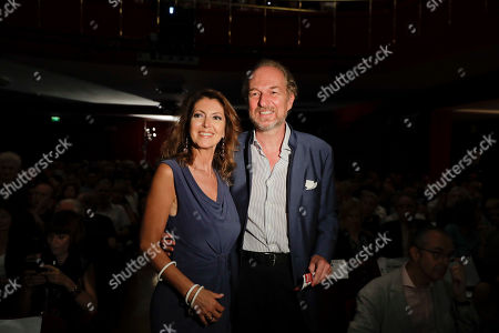 Stock Image of Italian entrepeneur Arturo Artom is flanked by his wife Alessandra Repini as they attend 'La Milanesiana' cultural event, at the Piccolo Teatro Grassi, in Milan, Italy