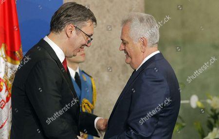 Aleksandar Vucic and former Serbian president Tomislav Nikolic