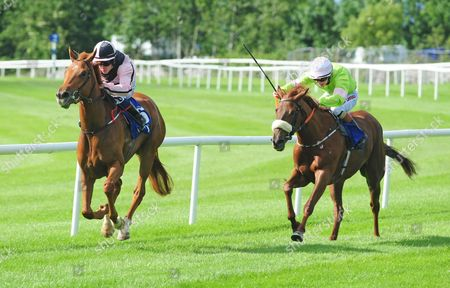 BALLINROBE ALL THE MOLLIES and Killian Leonard (right) win the John Madden & Sons Claiming Maiden from Sonic Wind (left). HEALY RACING