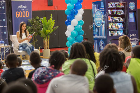 """Stock Image of South Florida native and actress Victoria Justice reading to local children from Carter Park's day camp program. JetBlue's """"Soar with Reading"""" free book vending machine program launches in Fort Lauderdale at Carter Park with actress Victoria Justice, author Mary Pope Osborne, local officials and community partners on in Fort Lauderdale, Fla"""