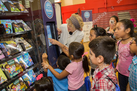 """Stock Picture of Magic Tree House series author Mary Pope Osborne vending a book with local children from Carter Park's day camp program. JetBlue's """"Soar with Reading"""" free book vending machine program launches in Fort Lauderdale at Carter Park with actress Victoria Justice, author Mary Pope Osborne, local officials and community partners on in Fort Lauderdale, Fla"""
