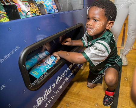 """Fort Lauderdale's youngest residents enjoying free books at the JetBlue Soar with Reading free book vending machine program launch event. JetBlue's """"Soar with Reading"""" free book vending machine program launches in Fort Lauderdale at Carter Park with actress Victoria Justice, author Mary Pope Osborne, local officials and community partners on in Fort Lauderdale, Fla"""