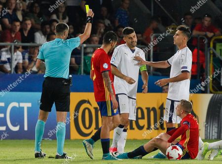 Italy's Benny Benassi, 3rd from left, gets a yellow card during the Euro Under 21 semifinal soccer match between Italy and Spain, at the Krakow Stadium, Poland