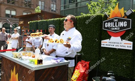 Stock Photo of Chef Josh Capon shows off his best grilling recipes during The Grilling Games presented by Pine Mountain and Royal Oak in New York's Astor Place