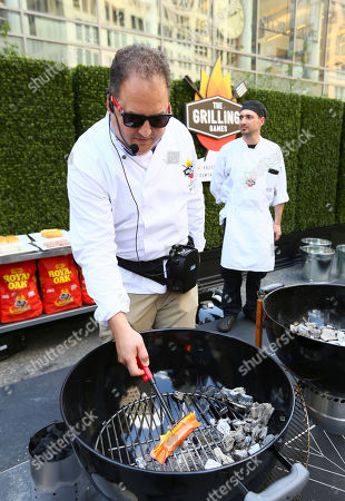 Stock Picture of Chef Josh Capon lights the ExtremeStart Firestarter from Pine Mountain for faster, mess-free charcoal grilling during The Grilling Games presented by Pine Mountain and Royal Oak in New York's Astor Place