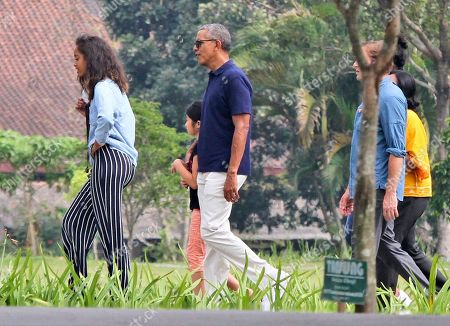 Barack Obama, Malia Obama Former U.S. President Barack Obama, center, walks with his daughter Malia, left, during his visit to Prambanan Temple in Yogyakarta, Indonesia, . Obama and his family are currently on a vacation in the country where he lived for several years as a child