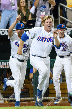 Omaha, NE U.S. - Florida pitcher Michael Byrne #17 leads teammates out of the dugout after the final out of game 2 of the Championship Finals of the NCAA Men's College World Series between LSU Tigers vs Florida Gators at TD Ameritrade Park in Omaha, NE..Attendance: 26,607.Florida won 6-1