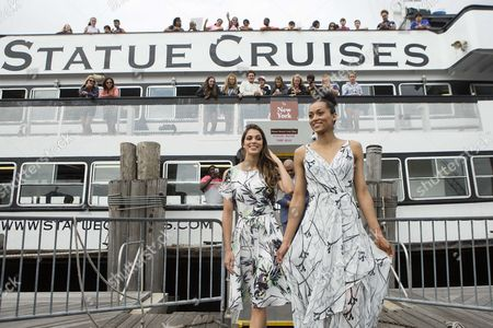Miss Universe, Iris Mittenaere, and Miss USA, Deshauna Barber exit the sightseeing cruise to Statue of Liberty and Ellis Island