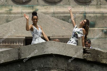 Stock Image of Miss Universe, Iris Mittenaere, and Miss USA, Deshauna Barber wave from Statue of Liberty during thier sightseeing cruise to Statue of Liberty and Ellis Island