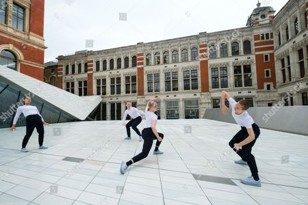 Stock Photo of Julie Cunningham & Company dancers perform in The Sackler Courtyard as part of the new V & A Exhibition Road Quarter.