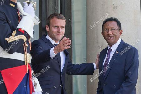 France's President Emmanuel Macron, left, welcomes Madagascar's President Hery Rajaonarimampianina at the Elysee Palace in Paris, France, . Madagascar's President Hery Rajaonarimampianina meets France's President Emmanuel Macron for bilateral talks