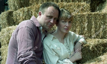 Zoe visits High Ridge Farm to examine a coughing heifer. The farmer, Ken Adlington, seems to take a shine to her. His wife, Margaret, does not seem keen - With Ken Adlington, as played by Douglas McFerran, and Margaret Adlington, as played by Kathy Jamieson. (Ep 1995 - 1st August 1995).