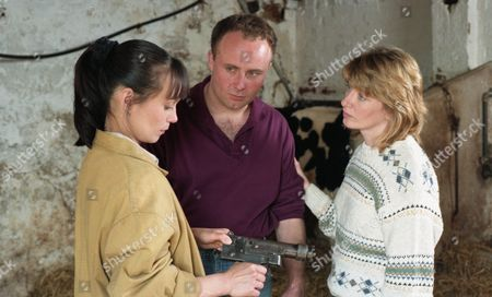 Stock Picture of Zoe arrives at High Ridge Farm to look at a sick heifer. The farmer, Ken Adlington, becomes upset when Zoe has to put it down and suspects lead poisoning - With Zoe Tate, as played by Leah Bracknell ; Margaret Adlington, as played by Kathy Jamieson, and Ken Adlington, as played by Douglas McFerran. (Ep 1997 - 8th August 1995).