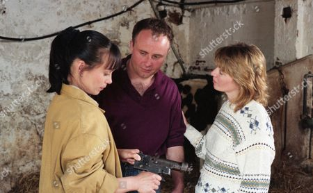 Zoe arrives at High Ridge Farm to look at a sick heifer. The farmer, Ken Adlington, becomes upset when Zoe has to put it down and suspects lead poisoning - With Zoe Tate, as played by Leah Bracknell ; Margaret Adlington, as played by Kathy Jamieson, and Ken Adlington, as played by Douglas McFerran. (Ep 1997 - 8th August 1995).