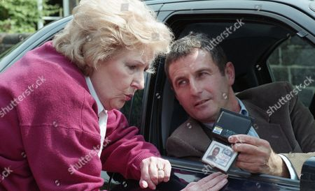 Betty notices a man in a car who appears to be watching Eric and Barbara. The man asks her what she is doing as she makes it obvious when she takes the registration number. She threatens to call the police and he tells her that actually he is the police - With Betty Eagleton, as played by Paula Tilbrook, and DS Metcalfe, as played by Ray Ashcroft. (Ep 1999 - 15th August 1995).