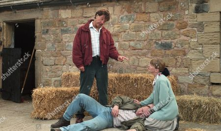 Stock Image of Frank is on his way to High Ridge Farm. He confronts Ken and punches him. Margaret comes running out of the house and claims that Zoe is lying as she was with her husband the whole time Zoe was at the farm - With Frank Tate, as played by Norman Bowler ; Margaret Adlington, as played by Kathy Jamieson, and Ken Adlington, as played by Douglas McFerran. (Ep 2002 - 22nd August 1995).