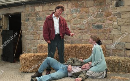 Frank is on his way to High Ridge Farm. He confronts Ken and punches him. Margaret comes running out of the house and claims that Zoe is lying as she was with her husband the whole time Zoe was at the farm - With Frank Tate, as played by Norman Bowler ; Margaret Adlington, as played by Kathy Jamieson, and Ken Adlington, as played by Douglas McFerran. (Ep 2002 - 22nd August 1995).