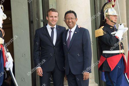 French President Emmanuel Macron greets President of Madagascar Hery Rajaonarimampianina