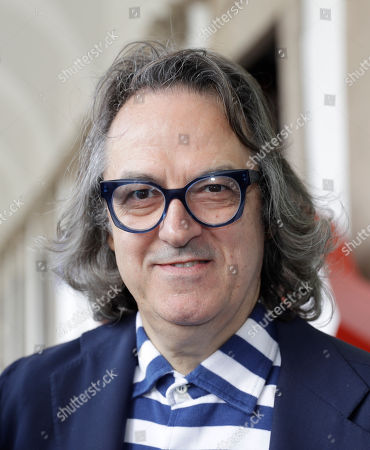RAI (Italian State Television) conductor Gigi Marzullo poses during the presentation of TV programs that will be aired in the next fall, in Milan, Italy