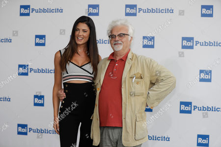 Stock Image of RAI (Italian State Television) conductors Daniela Ferolla and Patrizio Rovers pose during the presentation of TV programs that will be aired in the next fall, in Milan, Italy