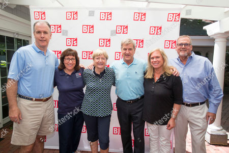 Chris Baldwin, President and Chief Executive Officer of BJ's Wholesale Club, from left, Cheryl Schondek, Vice President of Food Acquisition and Supply Chain of The Greater Boston Food Bank, Jane Blalock, LPGA Legend, Bobby Orr, Hockey Hall of Fame Member and representative of the Sandwich Food Bank, and two representatives from Cape Kid Meals with donations in honor of BJ's Charity Championship on in Sandwich, Mass