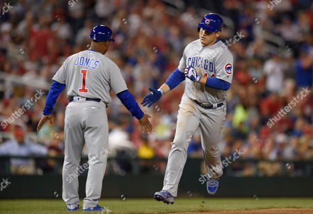 Anthony Rizzo, Gary Jones Chicago Cubs' Anthony Rizzo (44) rounds third and is greeted by third base coach Gary Jones (1) after his home run during the eighth inning of a baseball game against the Washington Nationals, in Washington. The Nationals won 8-4
