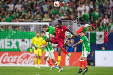 Stock Photo of Mexico defender Jair Pereira (3) and Ghana forward Asamoah Gyan (3) battle for a header during the 2nd half of an international soccer friendly match between Mexico and Ghana at NRG Stadium in Houston, TX. Mexico won the game 1-0