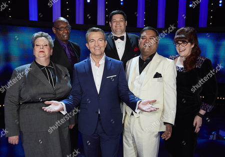 Host Bradley Walsh (centre) joins all The Chasers (l-r) stand-up comedian Paul 'The Sinnerman' Sinha, Anne 'The Governess' Hegerty, Shaun 'The Barrister' Wallace, Mark 'The Beast' Labbett and Jenny 'The Vixen' Ryan.
