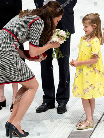 Catherine Duchess of Cambridge is presented with a posey by Lydia Hunt as she arrives at the V&A museum in London to officially open a new extension and entrance to the museum in London