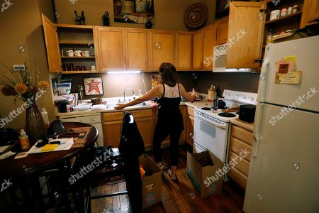 """Stock Image of Carolyn Horton reacts to the task of packing her belongings in her apartment, which she has to move out of, as her affordable housing subsidies expire at the American Can Apartments in New Orleans. Says Horton, """"My rent was $810, but they want to raise it to $1,100 or $1,200. Now I have to income-qualify for a new place and with just under $700 in Social Security, that's not easy"""
