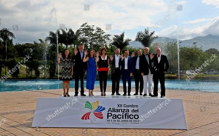 (L-R) Chilean Vice-Minister of Commerce Paulina Nazal, Colombian Minister of Finance and Public Credit Mauricio Cardenas, Colombian Minister of Commerce, Industry and Tourism Maria Claudia Lacouture, Colombian Minister of Foreign Affairs Maria Angela Holguin, Mexican Minister of Foreign Affairs Luis Videgaray, Mexican Secretary of Economy Ildefonso Guajardo, Mexican Secretary of Finance Jose Antonio Meade, Peruvian Minister of Foreign Affairs Ricardo Luna Mendoza and Peruvian Vice-Minister of Commerce Eduardo Ferreyros pose for the official picture of the XVIII Council of Ministers in the XII Pacific Alliance Summit, in Cali, Colombia, 29 June 2017.
