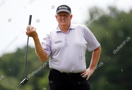 Colin Montgomerie, of Scotland, reacts after missing a putt on the second hole during the first round of the U.S. Senior Open golf tournament, in Peabody, Mass