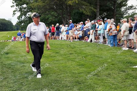 Colin Montgomerie, of Scotland, walks off the eighth green during the first round of the U.S. Senior Open golf tournament, in Peabody, Mass