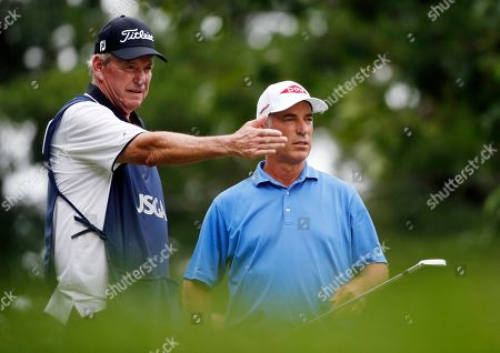 Eric Schwarz, Corey Pavin Corey Pavin talks with his caddie Eric Schwarz during the first round of the U.S. Senior Open golf tournament, in Peabody, Mass