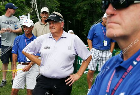 Colin Montgomerie, of Scotland, waits for this threesome on the eighth hole during the first round of the U.S. Senior Open golf tournament, in Peabody, Mass