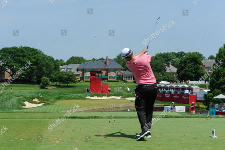 Greg Chalmers (USA) tees off from the elevated tee at hole number seventeen during the opening round at the Quicken Loans National at the Tournament Players Club in Potomac MD