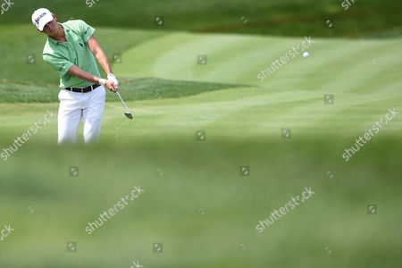 Stock Picture of Smylie Kaufman (USA) chips onto the free at number two during the opening round at the Quicken Loans National at the Tournament Players Club in Potomac MD
