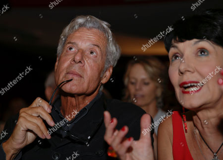 Italian singer and writer Claudio Baglioni, left, is flanked by Elisabetta Sgarbi as they attend 'La Milanesiana' cultural event, in Milan, Italy