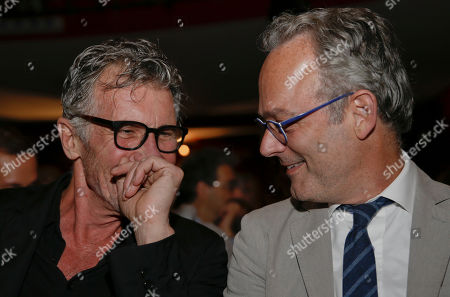U.S. writer Michael Cunningham, Pulitzer Prize-winning author of The Hours and By Nightfall, left, is flanked by U.S. writer Amor Towles as they attend 'La Milanesiana' cultural event, in Milan, Italy