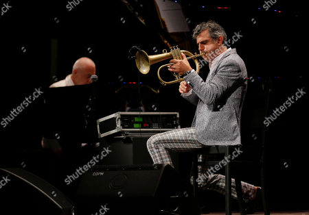 Italian trumpeter and phlogornist Paolo Fresu performs with pianist Roberto Cipelli in background, during 'La Milanesiana' cultural event, in Milan, Italy