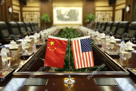 US and Chinese national flags are placed on a table for a meeting between Secretary of Agriculture Sonny Perdue and China's Minister of Agriculture Han Changfu at the Ministry of Agriculture in Beijing, China, 30 June 2017.