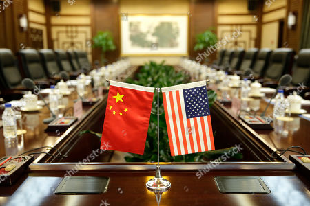 Flags of U.S. and China are placed for a meeting between Secretary of Agriculture Sonny Perdue and China's Minister of Agriculture Han Changfu at the Ministry of Agriculture in Beijing