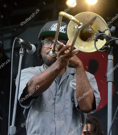 Stock Photo of Trumbone player Jay Armant of the band Fishbone performs live at Henry Maier Festival Park during Summerfest in Milwaukee, Wisconsin