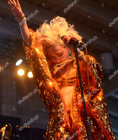 Stock Picture of Lead singer Margaret Butler of the band GGOOLLDD performs live at Henry Maier Festival Park during Summerfest in Milwaukee, Wisconsin
