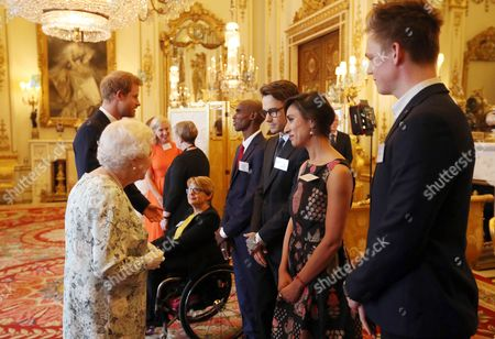 Queen Elizabeth II and Prince Harry greet (left to right) Dame Tanni Grey-Thompson, Mo Farah, Liam Payne, Anita Rani, and Caspar Lee during a reception prior to the Queen's Young Leaders Awards ceremony