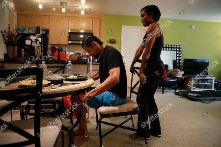 Shevon Stoddart, Jamie Nieto Shevon Stoddart, right, pushes in the chair for her fiance, Jamie Nieto, a two-time Olympic high jumper who is recovering from a spinal cord injury, at their dinner table, in Los Angeles. Nieto proposed to the Jamaican hurdler while in a wheelchair after the accident that initially left him paralyzed. He hopes to walk his bride down the aisle at their wedding on July 22