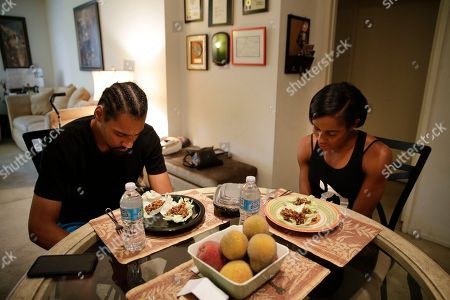 Shevon Stoddart, Jamie Nieto Two-time Olympian Jamie Nieto, left, and his fiancee Shevon Stoddart, a Jamaican hurdler, say grace before dinner in their apartment, in Los Angeles. On good days, Nieto can shuffle 130 steps without a cane or walker. That's an important distance for the two-time Olympic high jumper who's recovering from a spinal cord injury he suffered 14 months ago after a mistimed backflip. By his estimation, 130 paces takes him from the altar to the church door for their wedding on July 22