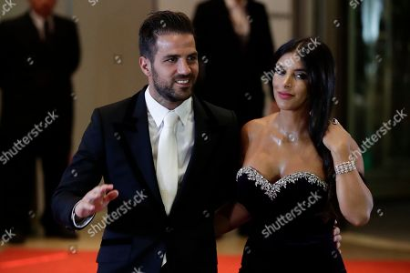 Daniella Semaan, Cesc Fabregas Chelsea's Cesc Fabregas, left, and Daniella Semaan pose for a photo before the start of the wedding of Lionel Messi and Antonella Roccuzzo, in Rosario, Argentina,. Some 260 guests, including teammates and former teammates of the Barcelona soccer star, are attending the highly anticipated ceremony