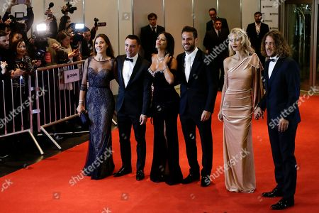 Carles Puyol, Vanessa Lorenzo, Cesc Fabregas, Daniella Semaan, Xavier Hernandez, Nuria Cunillera Carles Puyol, from right to left, Vanessa Lorenzo, Cesc Fabregas, Daniella Semaan, Xavier Hernandez and Nuria Cunillera, pose on the red carpet as they arrive to attend the wedding of Lionel Messi and Antonella Roccuzzo, in Rosario, Argentina, . About 250 guests, including teammates and former teammates of the Barcelona soccer star, are attending the highly anticipated ceremony